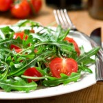 Light salad: arugula and tomatoes
